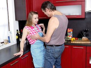 Steamy sex in the kitchen between young babe and old man